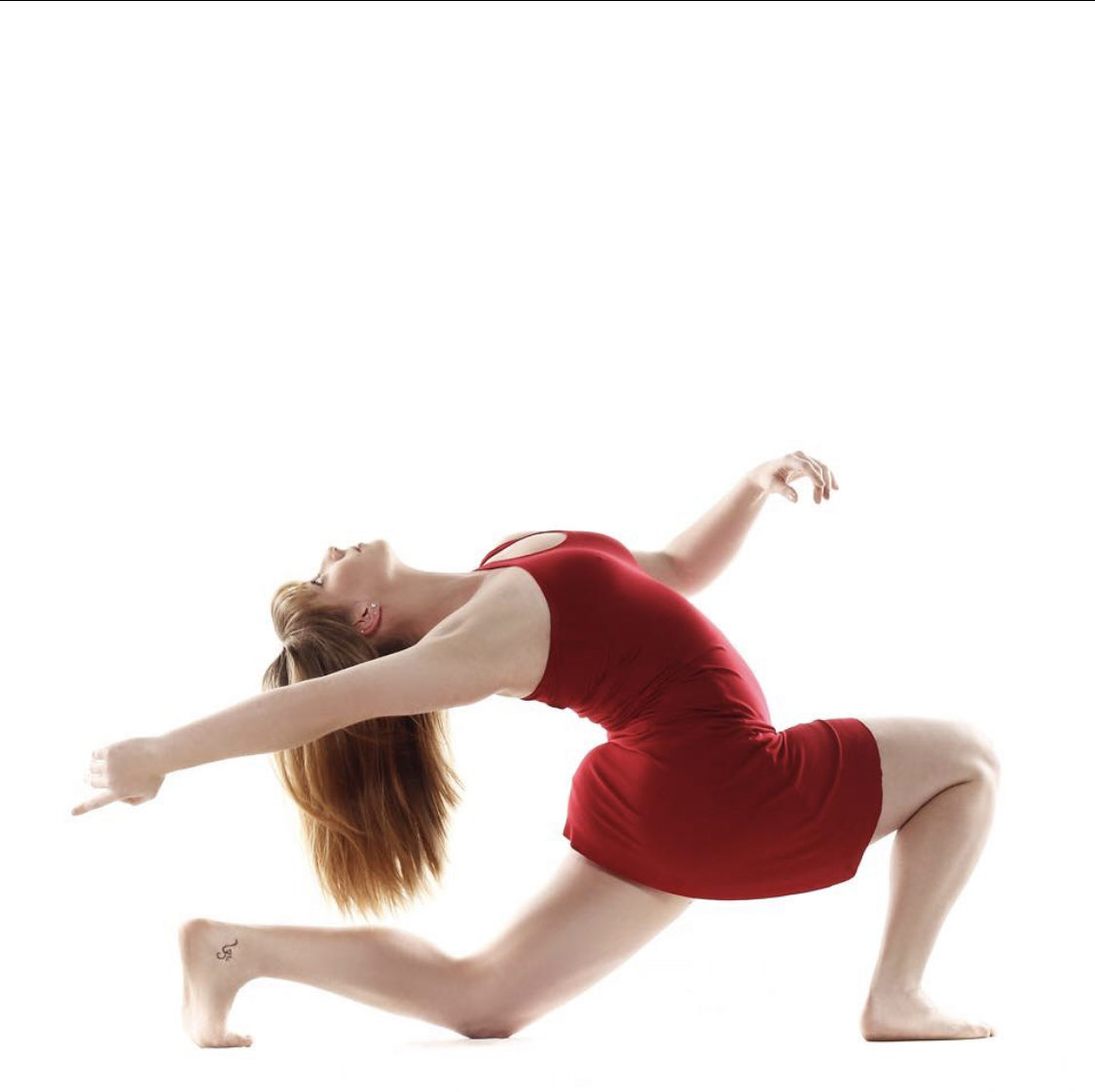 dancer in red dress lunge and back bend