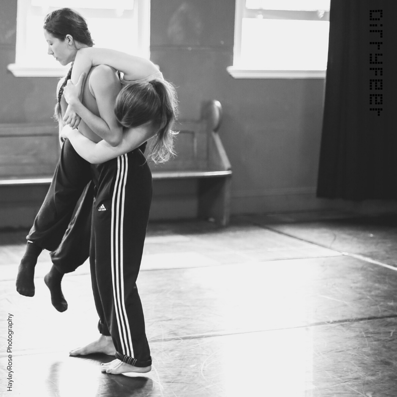 two dancers embracing
