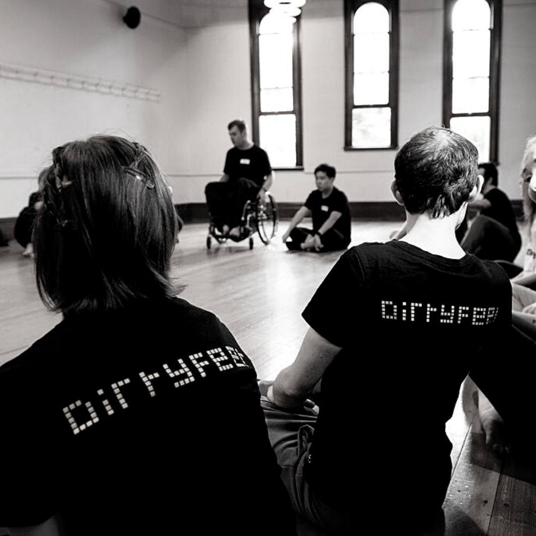 dancers wearing DirtyFeet tshirts facing back