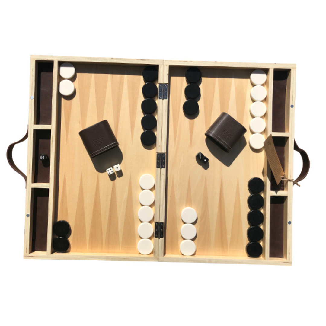 New for 2018, we are excited to finally launch our designer version of this classic game of strategy. Our full size backgammon design is crafted from beautiful linden plywood, a timber often used in guitars.  Each set when shut measures 49 x 32cm and comes with leather carry straps, two leather dice cups, 40mm ivory and black backgammon stones, 5-piece dice set and easy to follow backgammon rules.