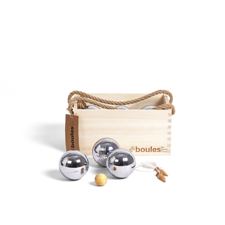 Our premium set of six boules comes in its own stylish hardwood carry crate with dovetail jointed corners and jute handles.  Each set comprises six polished 70mm steel boules, two 30mm wooden cachonet and measuring string with wooden toggle. The cachonet and measuring string toggle are finished in a clear varnish to beautify and protect.  This set of six boules suits two or three players with each player having two boules with its own distinctive stripe pattern.Our premium set of six boules comes in its own stylish hardwood carry crate with dovetail jointed corners and jute handles.  Each set comprises six polished 70mm steel boules, two 30mm wooden cachonet and measuring string with wooden toggle. The cachonet and measuring string toggle are finished in a clear varnish to beautify and protect.  This set of six boules suits two or three players with each player having two boules with its own distinctive stripe pattern.