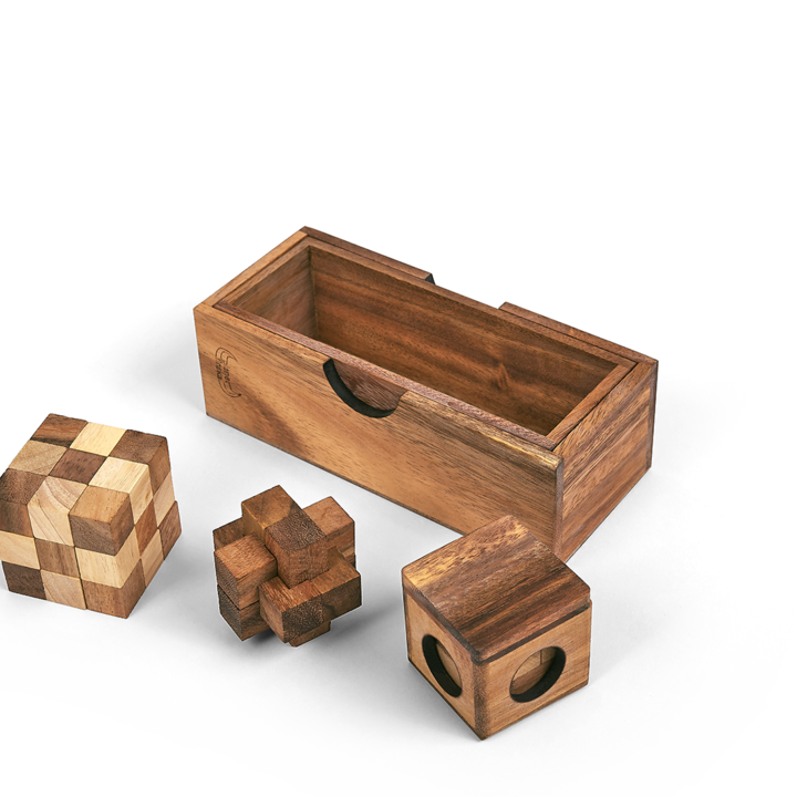 <p>This set of 3 larger hardwood puzzles includes the Snake Cube, the Soma Cube, and the Burr Puzzle. All are packed in beautiful timber box with lid. The individual puzzles are approx 60mm x 60mm x 60mm in size.</p>