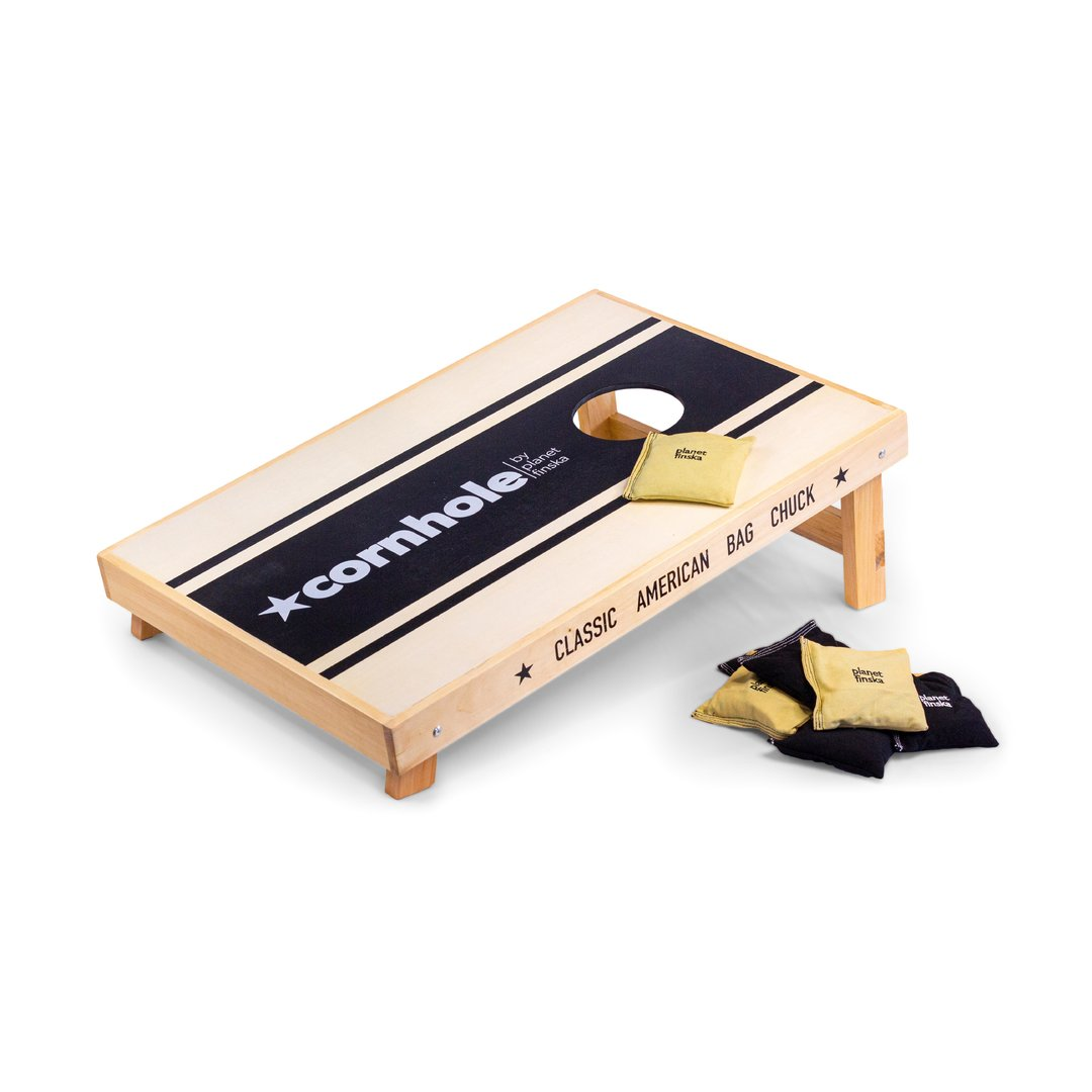 <p>New for 2019, Cornhole Standard sets have 3/4 length boards. This set has one standard sized board, and 8 heavy duty canvas cornhole bags (4 black and 4 khaki).&nbsp; The board has a storage drawer underneath to store the bags when not in use. Each board is 90cm x 60cm.</p>