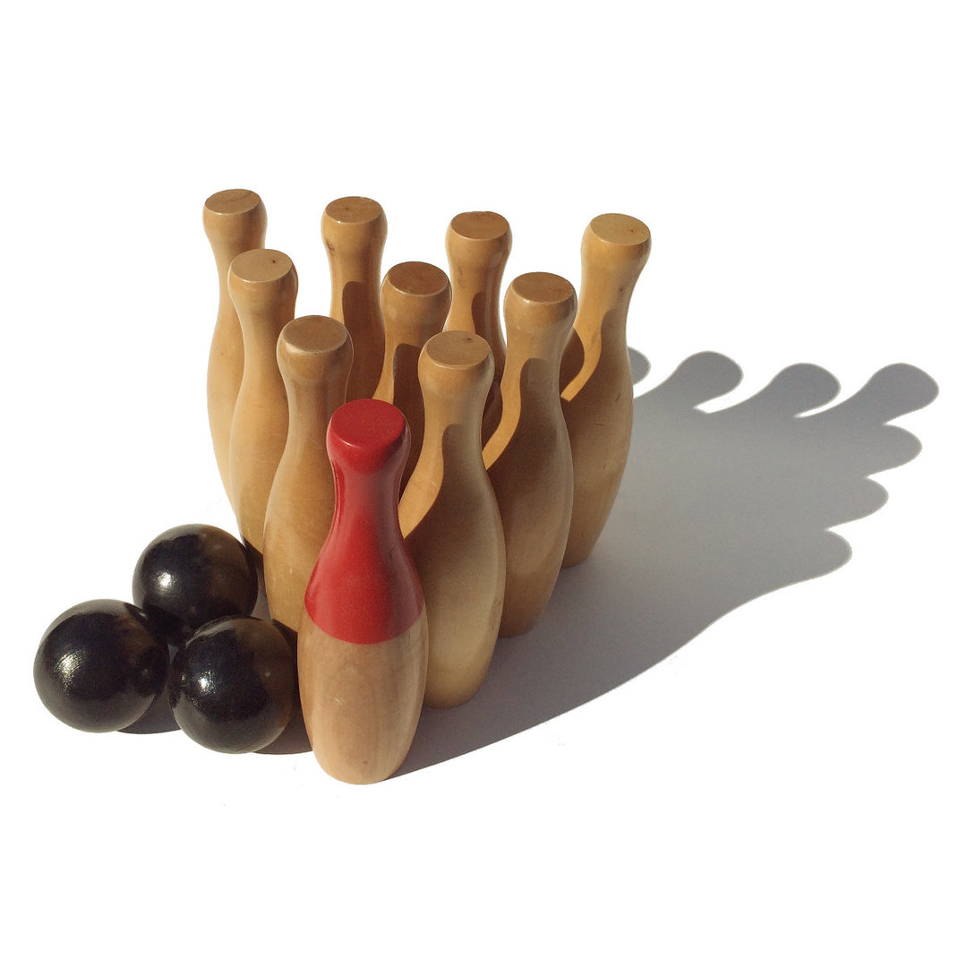 Knock 'em down.  This fabulous set of wooden skittles will bring hours of fun to young and old.  Each set comes with 10 beautifully turned hardwood skittles and three hand crafted wooden skittle balls in traditional black.