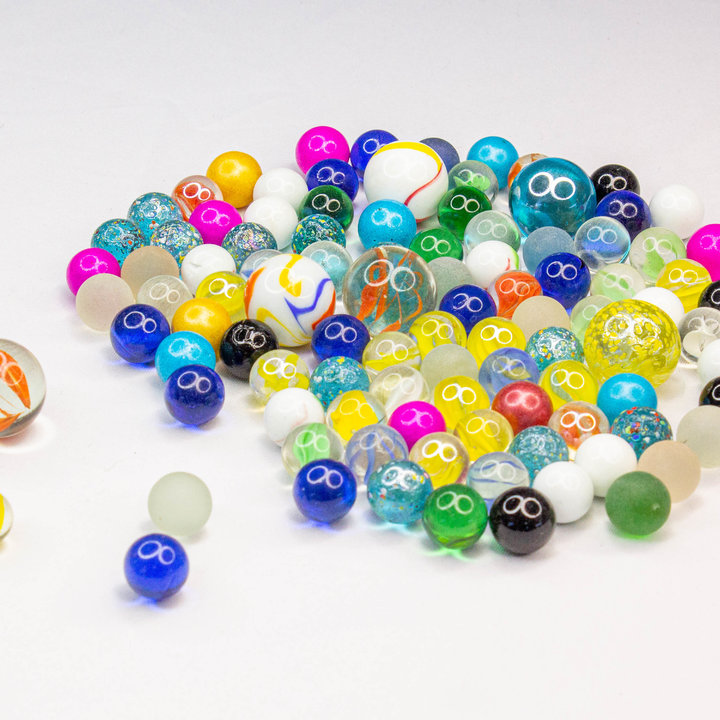 For marble lovers, this big bundle of 800 mixed glass marbles is sure to please.  Each bundle includes 8 bags of 100 premium marbles.  Each bag includes 96 standard 16mm marbles and 4 larger 25mm shooter marbles in a variety of custom designed colourful patterns.